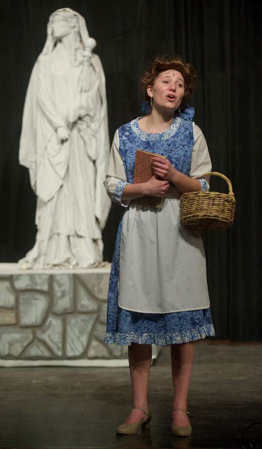 "Kathryn Kennedy, 17, a junior, plays Belle in Bethel High School's production of Disney's ""Beauty and the Beast"", in Bethel, Conn. Photo: H John Voorhees III / The News-Times Freelance"