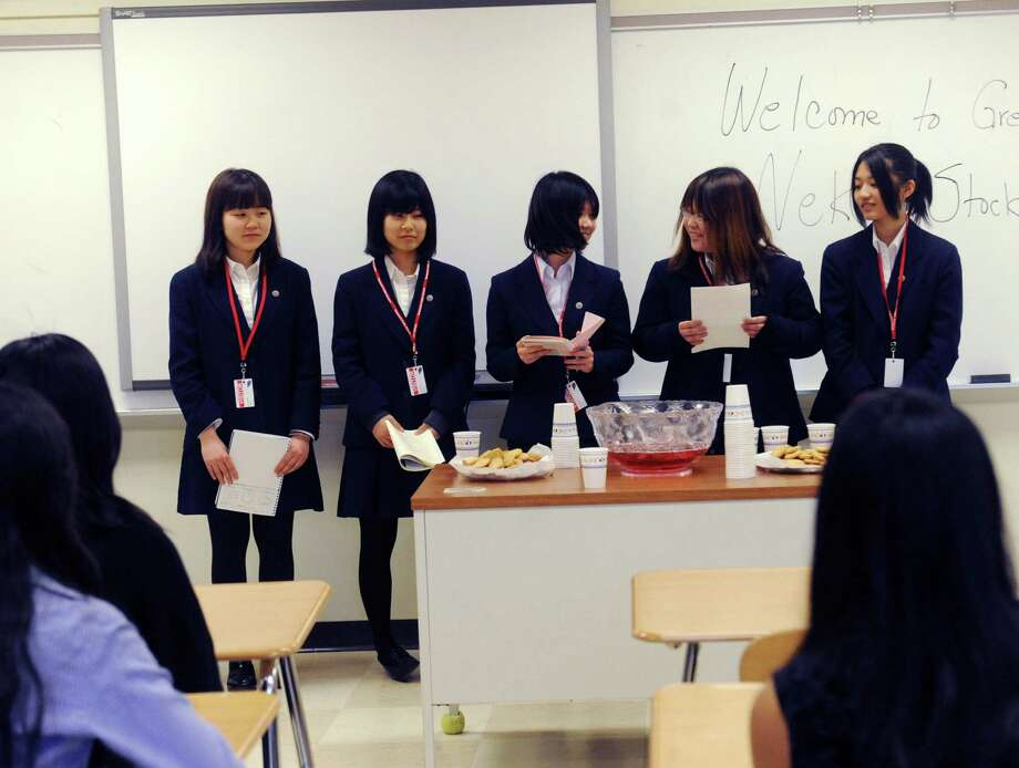 From left, Momo Hirata, Natsuno Otawara, Juri Takehata, Anzu Kato, Naho Asahara, the winning team of the Japanese Nikkei Stock League 2013, visited the Greenwich High School  business education department, in Greenwich, Conn., Wednesday, March 13, 2013. Photo: Helen Neafsey / Greenwich Time