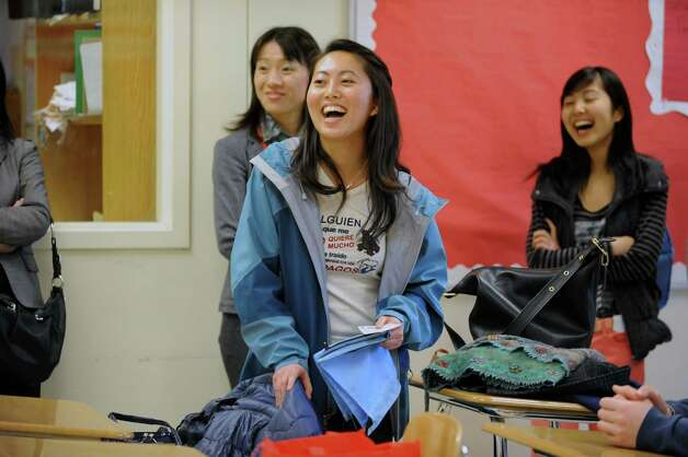 Misa Jitsuno, 18, left, an alumnus of Greenwich High School, interpreting for the winning team of the Japanese Nikkei Stock League 2013 at Greenwich High School , Greenwich, Conn., Wednesday, March 20, 2013. The Greenwich High School Business Education Department hosted the winning team of the Japanese Nikkei Stock League 2013, which is composed of five students from the Ochanomizu University Senior High School in Tokyo that is affiliated with Ochanomizu University. Photo: Helen Neafsey / Greenwich Time