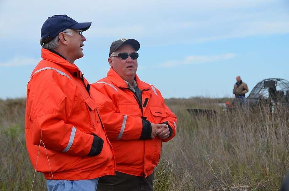 Interior Secretary Ken Salazar (left) talks with James Harris, the senior biologist for the Southeast Louisiana Refuges Complex, during a visit to the Big Branch refuge. Photo: Jennifer A. Dlouhy, Houston Chronicle