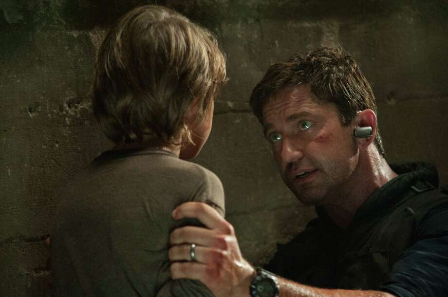 "Finley Jacobsen (left) and Gerard Butler star in ""Olympus Has Fallen."" Photo: FilmDistrict"