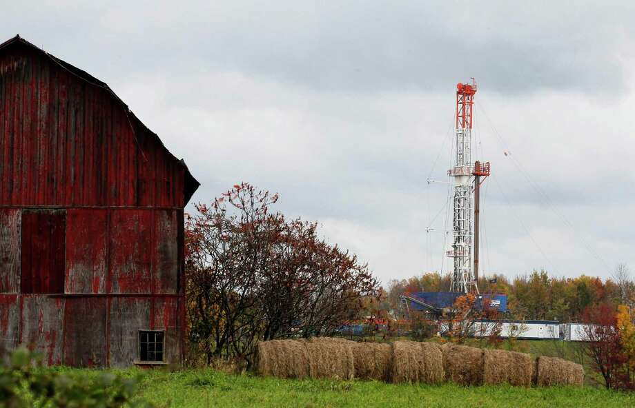 FILE - In this Oct. 14, 2011 file photo, a drilling rig is set up near a barn in Springville, Pa., to tap gas from the giant Marcellus Shale gas field. In an unlikely partnership between longtime adversaries, some of the nation's biggest energy companies and environmental groups announced Wednesday, March 20, 2013 that they have agreed on a voluntary set of standards for gas and oil fracking in the Northeast. (AP Photo/Alex Brandon, File) Photo: Alex Brandon, STF / AP