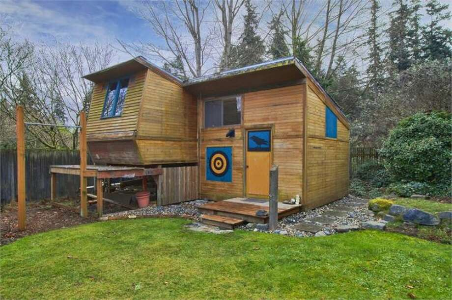 Backyard craft shop of 11661 N.E. Yeomalt Point Drive, on Bainbridge Island. The 962-square-foot A-frame house, built in 1963, has two bedrooms, one bathroom, lofted, exposed-wood ceilings, a wall of windows, a front deck and a back patio on a 9,148-square-foot lot with access to a community beach. It's listed for $284,000, although a sale is pending. Photo: Courtesy Wendy Indvik And Jim Lundwall/Windermere Real Estate