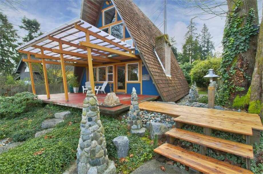 Ever wanted to live in an A-frame house on Bainbridge Island? Well, it's too late to buy this one, 11661 N.E. Yeomalt Point Drive, because a sale is pending. But you can take a virtual tour. The 962-square-foot house, built in 1963, has two bedrooms, one bathroom, lofted, exposed-wood ceilings, a wall of windows, a front deck, a back patio and a backyard craft shop on a 9,148-square-foot lot with access to a community beach. Hat tip to Curbed. Photo: Courtesy Wendy Indvik And Jim Lundwall/Windermere Real Estate