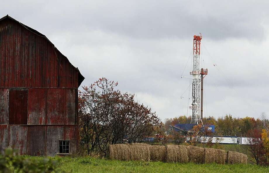 A drilling rig is set up near a barn in Springville, Pa., to tap gas from the giant Marcellus Shale field in 2011. A new Northeast deal sets tough standards. Photo: Alex Brandon, Associated Press