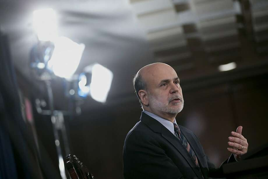 Fed Chairman Ben Bernanke says the central bank will base its bond purchases on the jobless rate. Photo: Andrew Harrer, Bloomberg