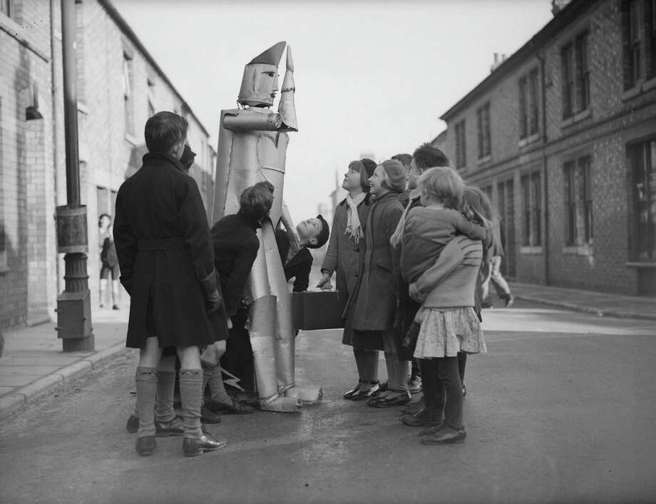 15th January 1939:  The children of Kettering in Northamptonshire stare in amazement at a walking talking robot, the invention of local electrical engineer Charles Lawson. Photo: Harry Todd, Getty / Hulton Archive