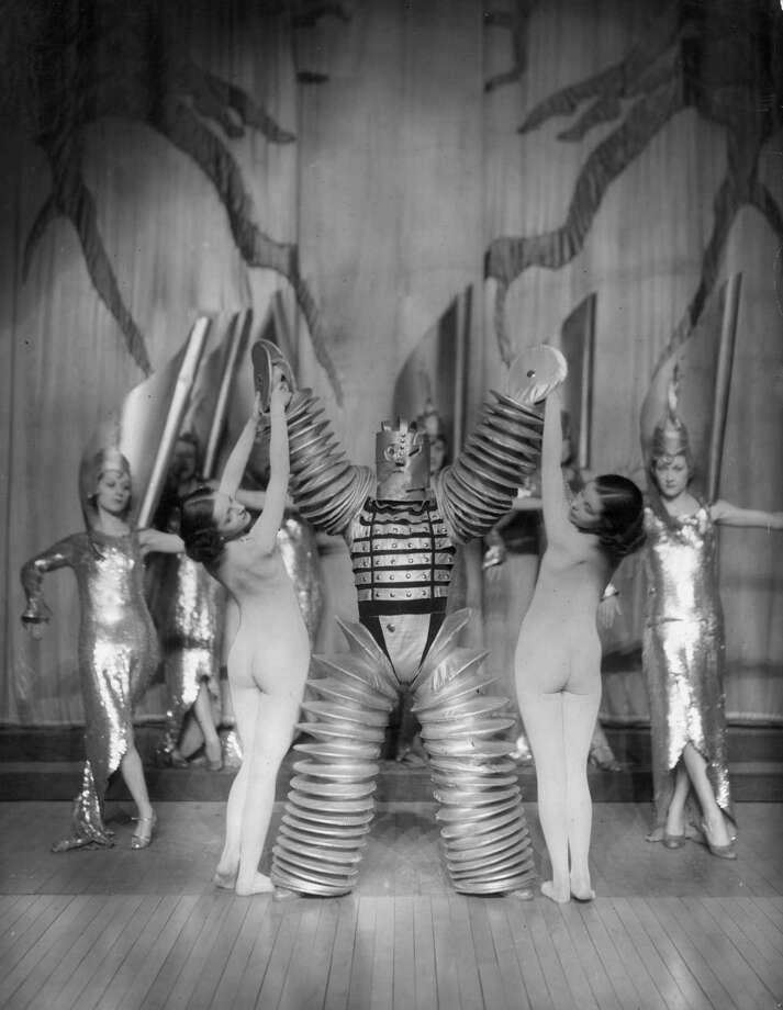 1937:  Two nude women dance on stage with a 'robot' in a show at London Casino. Photo: General Photographic Agency, Getty / Hulton Archive