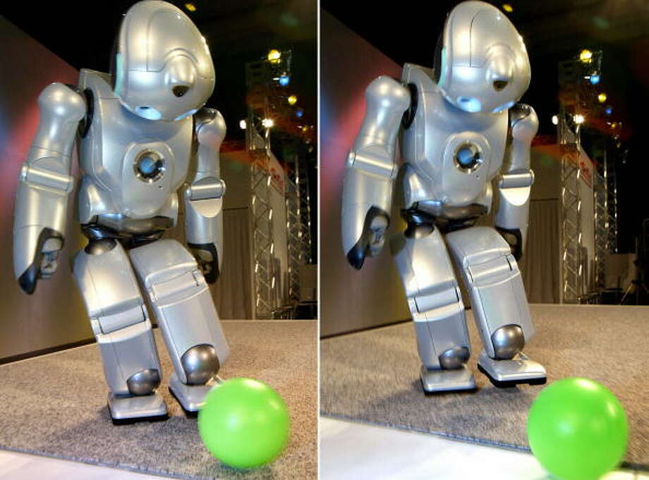 "This combo picture shows Sony's entertainment robot ""SDR-4X II"" kicking a ball at the National Museum of Emerging Science and Inovation (MeSci) in Tokyo 24 August 2003. Sony's humanoid robot, 58cm in height and weighing 7kg equipped with 3CPU and 38 micro actuators, shows his latest performance before children.     AFP PHOTO/Yoshikazu TSUNO Photo: YOSHIKAZU TSUNO, Getty / 2003 AFP"