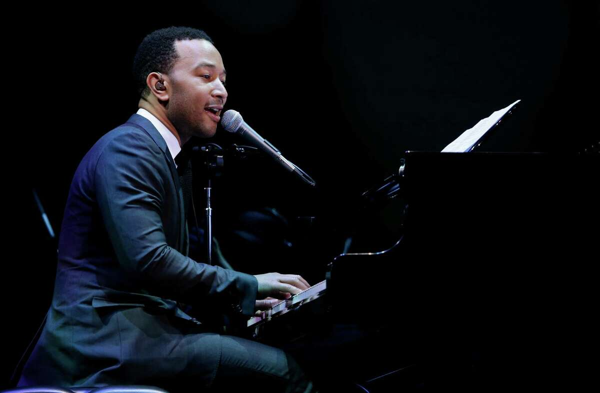 Singer John Legend performs during Starbucks Corp.'s annual shareholders meeting, Wednesday, March 20, 2013, in Seattle.