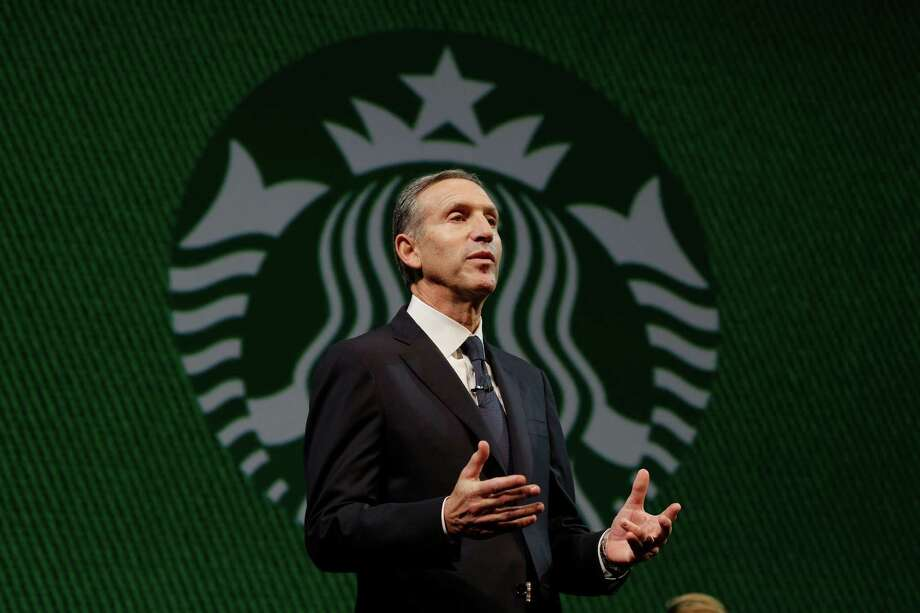 Starbucks CEO Howard Schultz speaks in front of the Starbucks logo during the company's annual shareholders meeting, Wednesday, March 20, 2013, in Seattle. Photo: Ted S. Warren / Associated Press