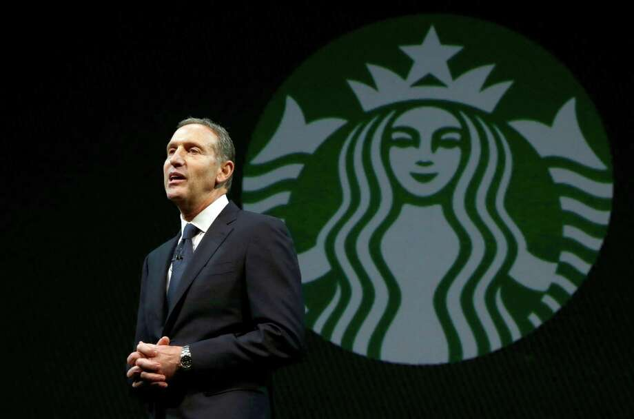 Starbucks CEO Howard Schultz speaks at the company's annual shareholders meeting, Wednesday, March 20, 2013, in Seattle, Wash. Photo: Ted S. Warren / Associated Press
