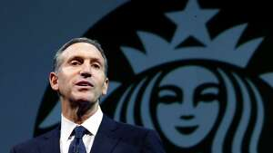 Starbucks CEO Howard Schultz speaks at the company's annual shareholders meeting, Wednesday, March 20, 2013, in Seattle, Wash.