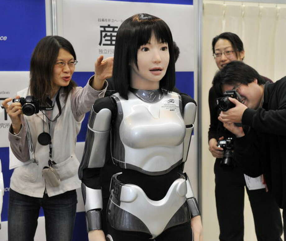 "Japan's government sponsored research laboratory AIST unveils the new humanoid robot """"HRP-4C"", 158cm in tall and weighing 43kg, is able to make human face like motion during a demonstration which enables it to make human like motion at the AIST laboratory in Tsukuba city in Ibaraki prefecture, suburban Tokyo on March 16, 2009. The HRP-4C, called Cybernetic Human, has 42 actuators and several sensors on its body, will debut at a fashion show of the Tokyo collection later this month. AFP PHOTO / Yoshikazu TSUNO Photo: YOSHIKAZU TSUNO, Getty / 2009 AFP"