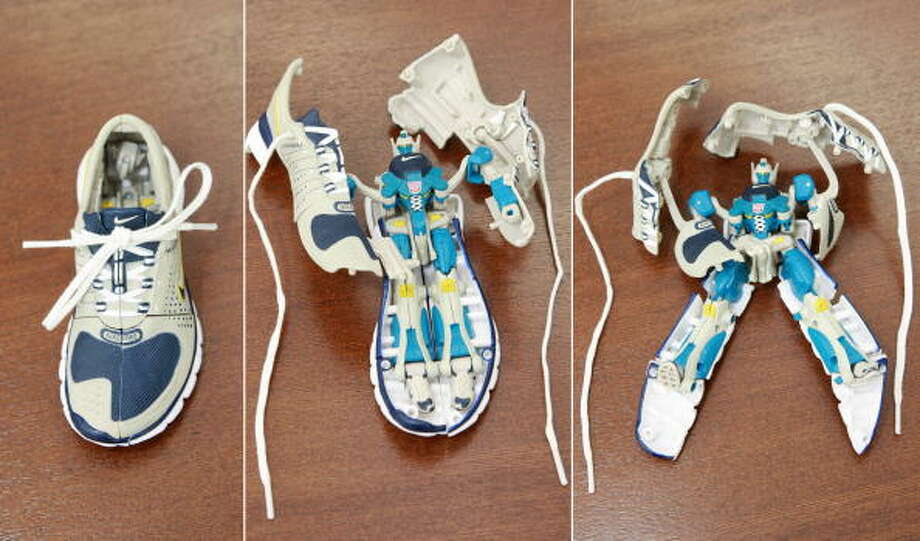 "This combo shows pictures of various stages of transformation of the new ""Transformers Sports Label"" robot toy from Japanese toy giant Tomy in Tokyo, 14 August 2007.  The product changes shape from the original 13.5cm long miniature Nike sneaker ""Free 7.0"" (far L) into a transformer robot.   AFP PHOTO / Yoshikazu TSUNO Photo: YOSHIKAZU TSUNO, Getty / 2007 AFP"