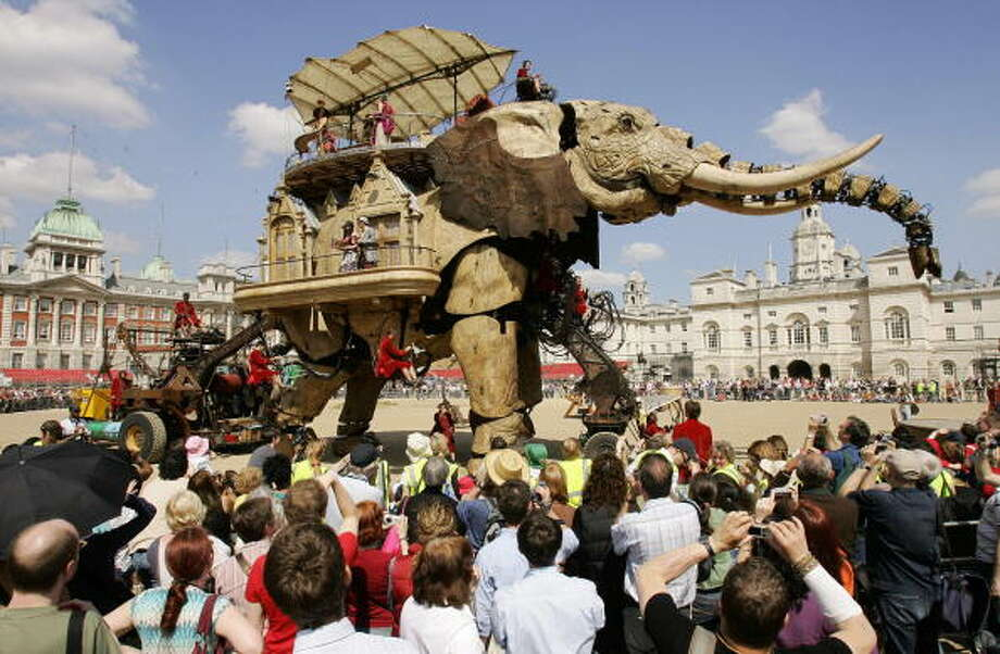 A large robotic elephant entertains the crowds in central London, 05 May 2006, as part of an outdoor theatre production called 'The Sultan's Elephant,' a show by Royal De Luxe. The show will be acted out in various locations in central London over the next four days. AFP PHOTO/CARL DE SOUZA Photo: CARL DE SOUZA, Getty / 2006 AFP