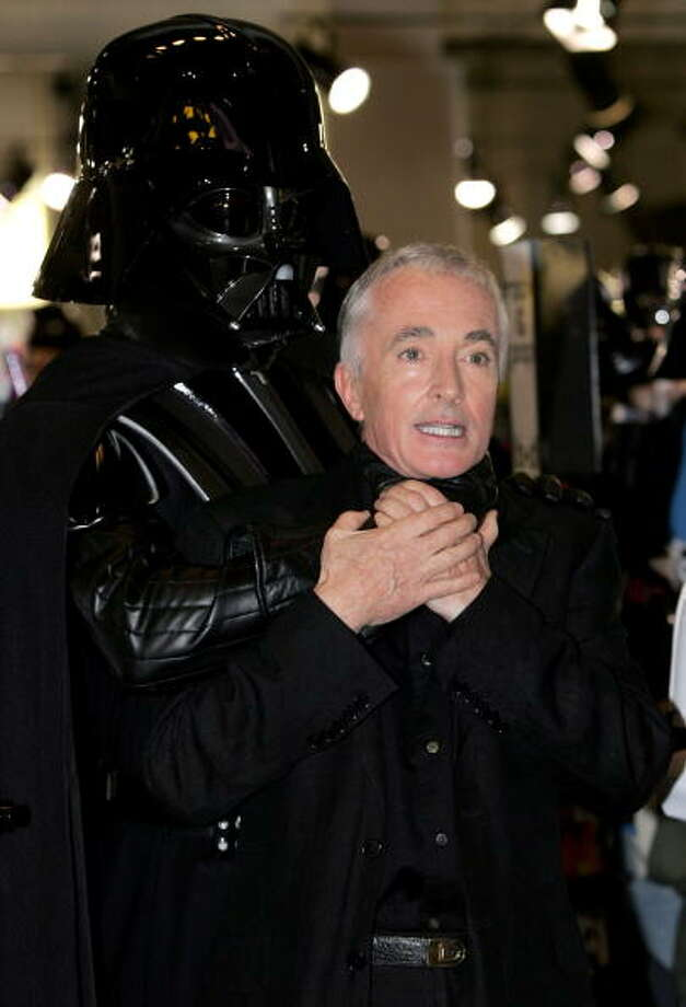"Most misunderstood half man/half robot? Darth Vader, pretends to throttle Star Wars actor Anthony Daniels, who plays the android C3PO in the series of films during a signing of copies of the latest DVD in the collection, ""Star Wars Episode III: Revenge Of The Sith"" at HMV Oxford Street on October 31, 2005 in London, England. The signing takes place on Star Wars's National Day Of Darkness, which also sees 300 Darth Vaders joining Daniels in the store. Photo: Gareth Cattermole, Getty / 2005 Getty Images"