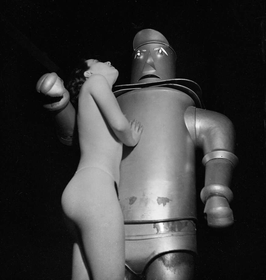 Woman and a robot. France, about 1935. Photo: Gaston Paris, Getty / Gaston Paris/Roger Viollet