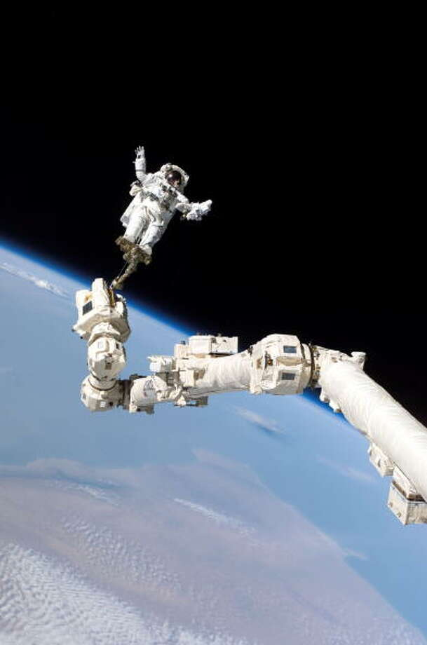 Advancements in robotics also provide for advancement in other sciences, too.In this NASA handout: mission specialist, Astronaut Stephen K. Robinson, is anchored to a foot restraint on the International Space Station's Canadarm2 robotic arm, during his space walk to repair the underside of the space shutttle Discovery August 3, 2005. Space shuttle Discovery is scheduled to return to Earth August 8. Photo: Handout, Getty / 2005 Getty Images