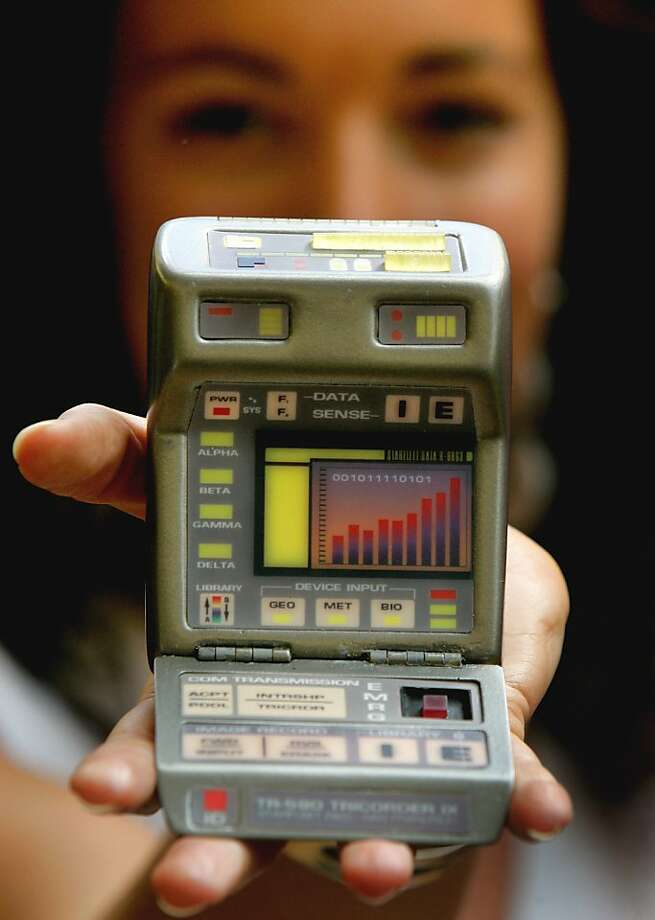 Zoe Schoon from Christie's auction rooms, London, displays a Tricorder Prop from Insurrection, a Star Trek telvision series, estimated at US$500-700, Wednesday Aug. 2, 2006. The instrument is part of a public exhibition in London, ahead of an auction on Oct. 5-7, 2006 in New York, auctioning over 1000 Star Trek lots from the original CBS Paramount Television Studios. (AP Photo/Kirsty Wigglesworth) Photo: Kirsty Wigglesworth, AP