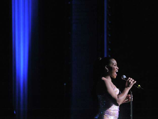 Broadway actress Rashidra Scott sings during an event at Proctors to unveil the  titles for next season's Broadway series on Wednesday, March 20, 2013 in Schenectady, NY.  Scott played in the broadway show Sister Act.  (Paul Buckowski / Times Union) Photo: Paul Buckowski