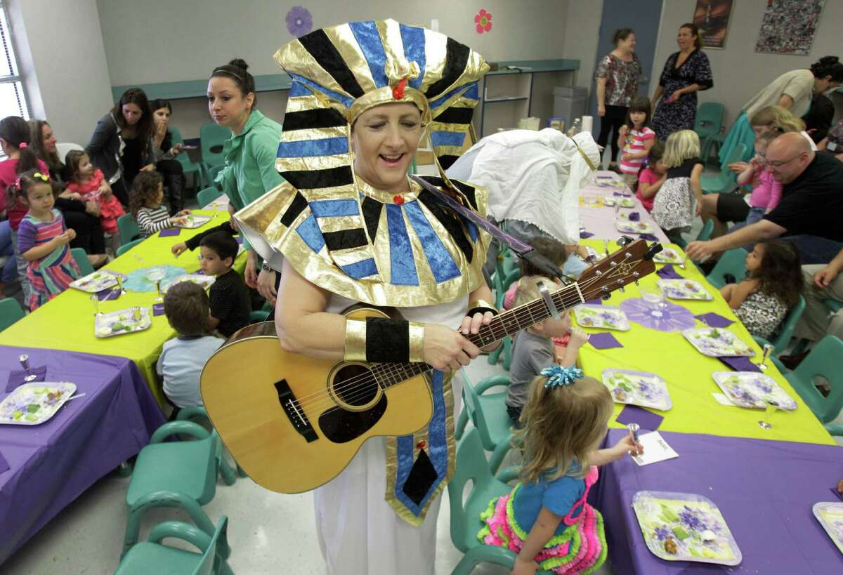 Cathy Shelley, music director, portrays King Pharaoh for a group of three-year-old preschool students participating in a Passover Seder at Bertha Alyce Early Childhood Center in Houston. The Passover Seder is a Jewish ritual meal that marks the beginning of the Jewish holiday of Passover. Each item on the plate has a special significance to the retelling of the story of the exodus from Egypt, which is the focus of this ritual meal. Passover begins at sundown March 25, 2013.