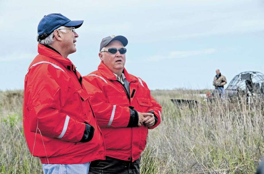 Interior Secretary Ken Salazar, left, talks with senior biologist James Harris during a visit to the Big Branch National Wildlife Refuge on Wednesday. Photo: Jennifer A. Dlouhy