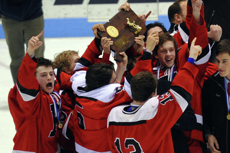Fairfield Warde/Ludlowe Mustang team members celebrate their win over East Catholic, during CIAC Division II boys hocksey state final action at Ingalls Rink in New Haven, Conn. on Wednesday March 20 2013. Photo: Christian Abraham / Connecticut Post