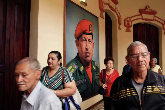 A painting of Venezuela's late President Hugo Chavez in a military uniform hangs near his tomb at the Military Museum in Caracas, Venezuela, Wednesday, March 20, 2013. Chavez died on March 5.