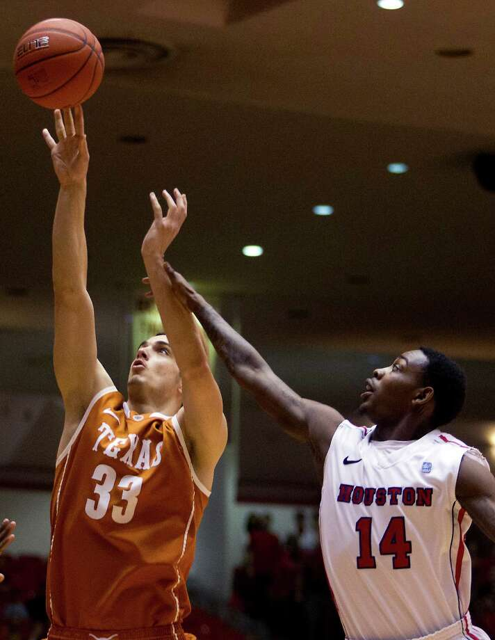 Texas forward Ioannis Papetrou (33) puts up a shot against UH guard Tione Womack (14). Photo: J. Patric Schneider, For The Chronicle / © 2012 Houston Chronicle