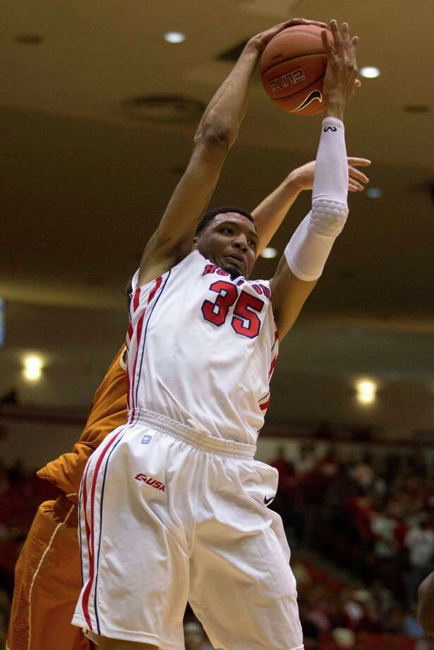 UH forward TaSawn Thomas (35) brings down a rebound. Photo: J. Patric Schneider, For The Chronicle / © 2013 Houston Chronicle