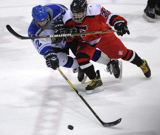 Fairfield Warde/Ludlowe Mustang's #22 Kyle Scheetz, right, and East Catholic's #22 Evan Cedrone struggle for control of the puck, during CIAC Division II boys hocksey state final action at Ingalls Rink in New Haven, Conn. on Wednesday March 20 2013. Photo: Christian Abraham / Connecticut Post