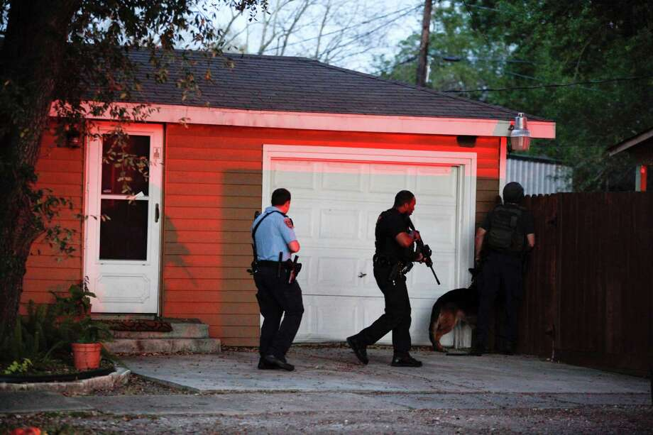Police search for the suspect after the shooting along the 10400 block of North Oswego in Jacinto City on Wednesday. Photo: Eric Kayne, For The Chronicle / © 2013 Eric Kayne
