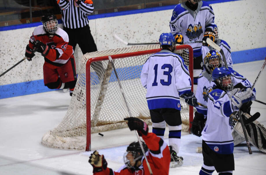 CIAC Division II boys hockey state final action between Fairfield Warde/Ludlowe Mustang and East Catholic at Ingalls Rink in New Haven, Conn. on Wednesday March 20 2013. Photo: Christian Abraham / Connecticut Post