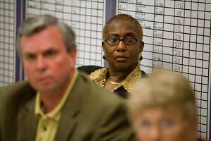Kashmere High School principal Mabel Caleb (cq), listens to her lawyer Chris Tritico talk about her problems with HISD and her possible termination during a press conference Thursday, Jan. 21, 2010, in the Houston Federation of Teachers office in Houston. ( Nick de la Torre / Chronicle )