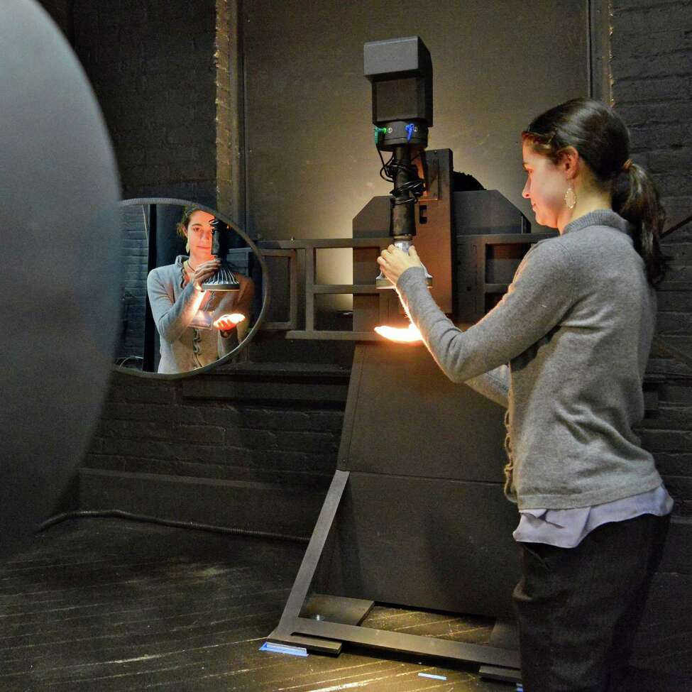 Masters of science and lighting student Erin Ryan prepares an LED lamp for measurement in RPI 's new photometry lab adjusts LED's inside a 2 meter integrating sphere at their Lighting Research Center in Troy Wednesday March 20, 2013. (John Carl D'Annibale / Times Union)