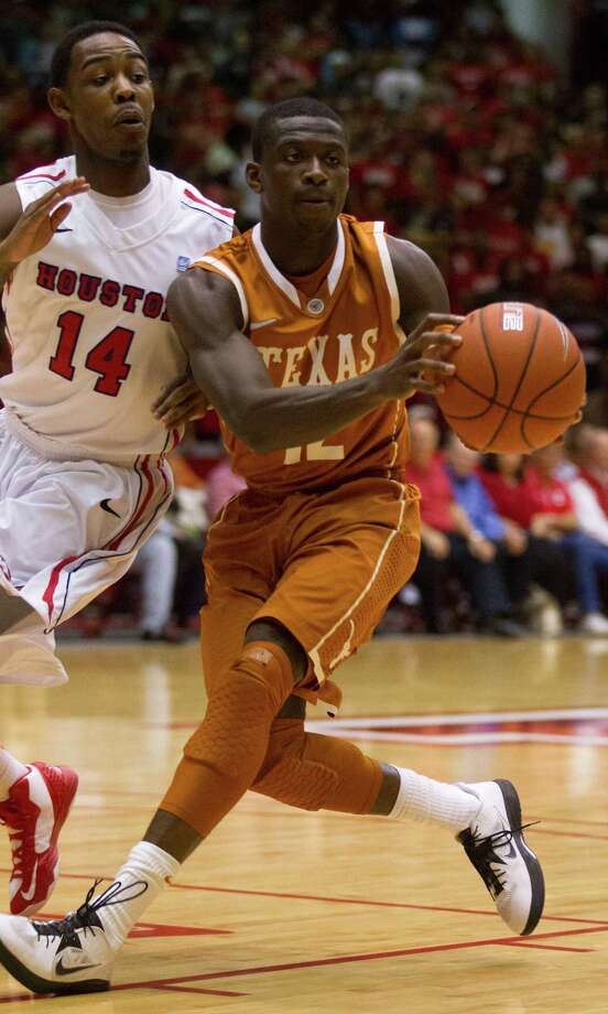 UT's Myck Kabongo (12) drives against UH guard Tione Womack (14). Photo: J. Patric Schneider, For The Chronicle / © 2012 Houston Chronicle