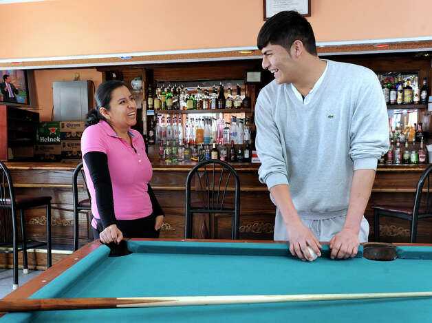 Lorena Viveros, 36, left, and Jose Minchala, 21, chat together at El Milenio, an Ecuadorean restaurant on North Street, in Danbury, Conn., Wednesday, March 20, 2013. Viveros is from Mexico and Michala is from Ecuador. Photo: Carol Kaliff / The News-Times