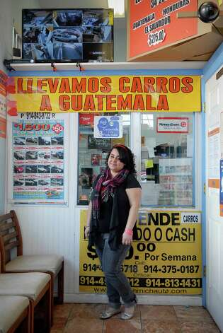 Mayra Aragon, who came to the U.S. from Guatemala at 11 with her family, works at Guatelinda Express/Travel in Stamford, Conn. on Friday March 15, 2013. Photo: Dru Nadler / Stamford Advocate Freelance