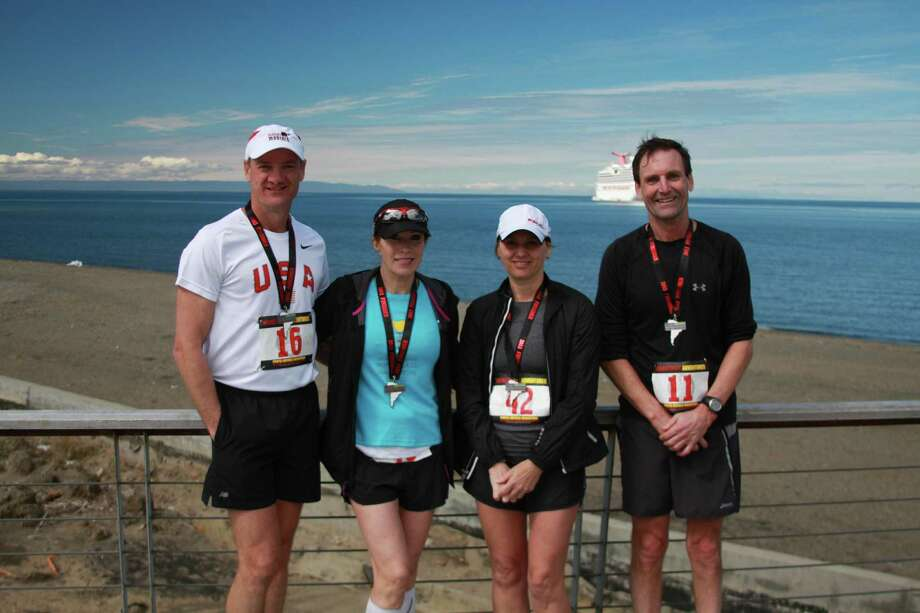 Houston runners Lou Kneeshaw, from left, Suzy Seeley, Patti Kroger and Bill Butzner sport their medals from last month's Punta Arenas Marathon in Chile. Photo: Courtesy Of Lou Kneeshaw