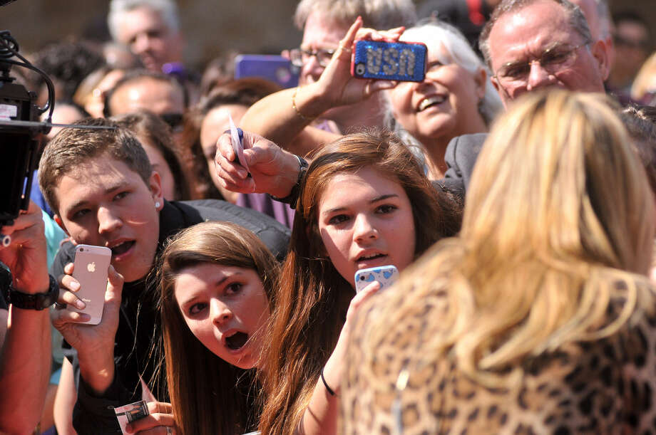 "Crowds watch as Heidi Klum, one of the celebrity judges on ""America's Got Talent,"" arrives for the show's taping. Photo: Robin Jerstad, For The San Antonio Express-News"