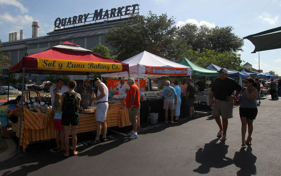 The new rules governing the vending of prepared foods at farmers markets like this one at the Alamo Quarry Market still have to be approved by the City Council. Photo: John Davenport / San Antonio Express-News