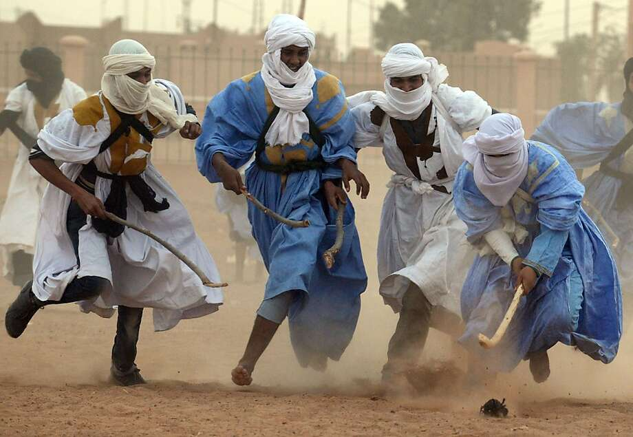 Nomads vie for the ball during a match of nomad hockey, played on sand, in the Moroccan desert on March 16, 2013 in M'hamid El Ghizlane, southeast of Zagora. FADEL SENNA/AFP/Getty Images Photo: Fadel Senna, AFP/Getty Images
