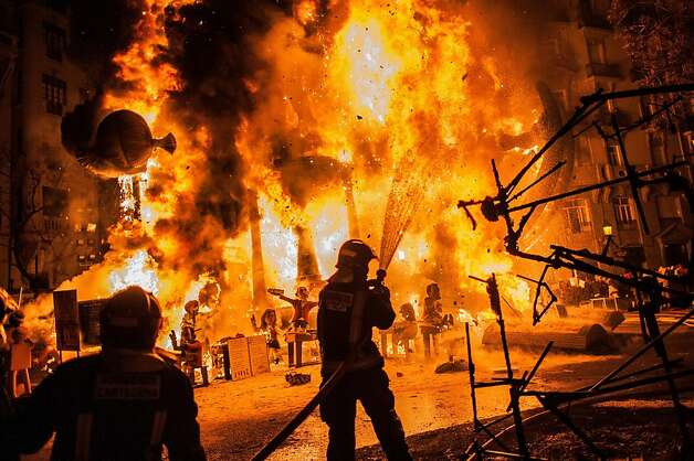 Firefighters put out a Falla during the last day of the Las Fallas Festival on March 20, 2013 in Valencia, Spain. The Fallas festival, which runs from March 15 until March 19, celebrates the arrival of spring with fireworks, fiestas and bonfires made by large puppets named Ninots.  (Photo by David Ramos/Getty Images)  Photo: David Ramos, Getty Images