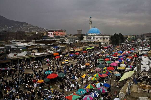 Afghans shop at an open air market a day before the celebration of the Persian New Year Nowruz in Kabul, Afghanistan, Wednesday, March 20, 2013. Nowruz marks the first day of spring and the beginning of the year on the Iranian calendar. (AP Photo/Ali Hamed Haghdoust) Photo: Ali Hamed Haghdoust, Associated Press