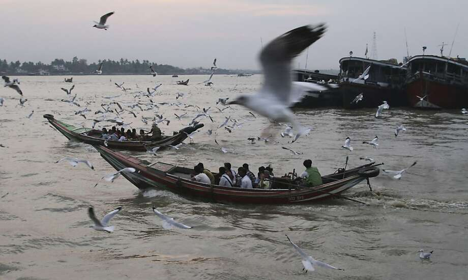 In this photo taken on Tuesday, March 19, 2013, passengers take ferry boats to cross over Yangon river in Yangon, Myanmar. (AP Photo/Khin Maung Win) Photo: Khin Maung Win, Associated Press
