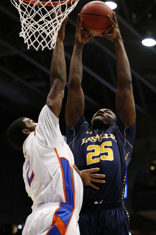 DAYTON, OH - MARCH 20:  Jerrell Wright #25 of the La Salle Explorers goes up against Derrick Marks #2 of the Boise State Broncos in the first half during the first round of the 2013 NCAA Men's Basketball Tournament at University of Dayton Arena on March 20, 2013 in Dayton, Ohio.  (Photo by Gregory Shamus/Getty Images)