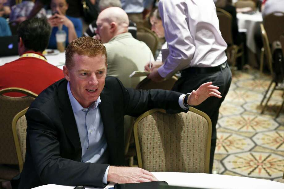 Cowboys coach Jason Garrett speaks with the media Wednesday at the owners meetings in Phoenix. He said he hasn't decided who will call the offensive plays for Dallas next season. Photo: Ross D. Franklin / Associated Press