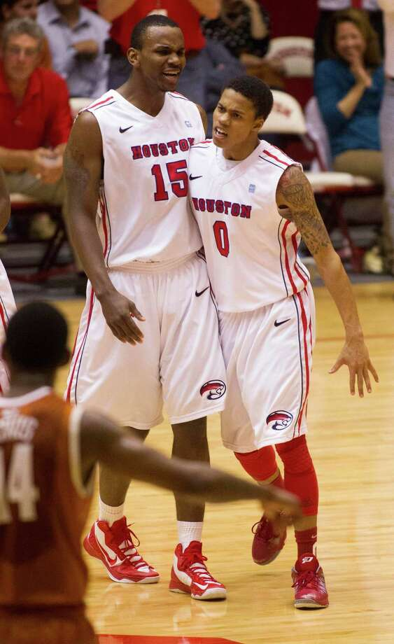 UH forward Leon Gibson (15) and guard Joseph Young (0) celebrate after Gibson made a basket. Photo: J. Patric Schneider, For The Chronicle / © 2013 Houston Chronicle