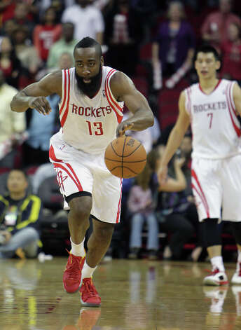 Rockets guard James Harden drives the ball against the Jazz. Photo: James Nielsen, Houston Chronicle / © 2013 Houston Chronicle